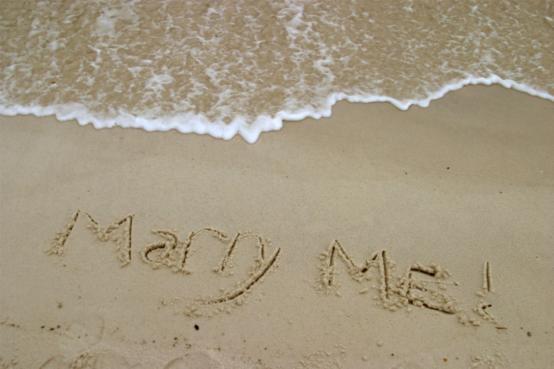 Marry Me written in sand, proposal, engagment ring, drakes jewellers
