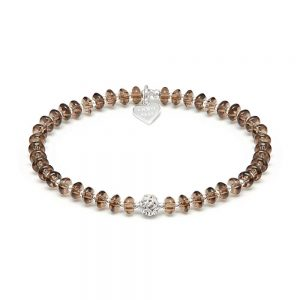 Create texture and depth with this simplistic Smokey Quartz and Sterling Silver stackable bracelet, presenting an abstract 'Knot' bead centrepiece.