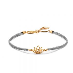 A delightful stackable friendship bracelet in grey silk cord featuring a 14ct plated gold lotus charm, a symbol of wellbeing.